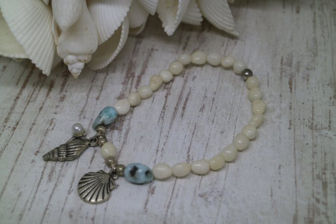 White shell Larimar gemstone bracelet with silver shell charms