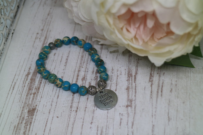 Blue Sea Sediment Jasper gemstone beaded bracelet with silver 'live laugh love' charm