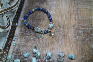 Blue Sea Sediment Jasper gemstone bead bracelet with Larimar nuggets with silver turtle charm