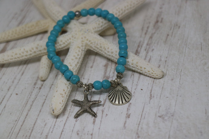 Blue Howlite bead bracelet with a silver starfish and shell charm