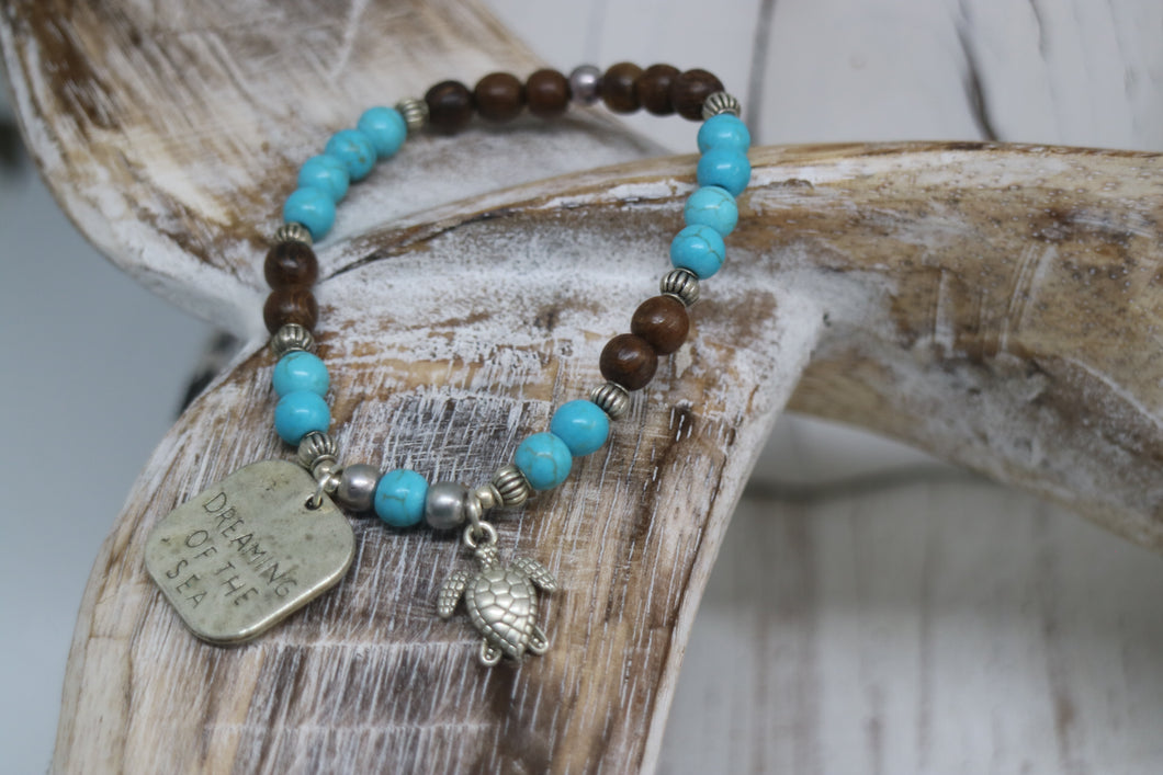 Blue howlite gemstone and wood beaded bracelet with silver rustic 'dreaming of the sea' and turtle charms