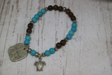 Load image into Gallery viewer, Blue howlite gemstone and wood beaded bracelet with silver rustic 'dreaming of the sea' and turtle charms
