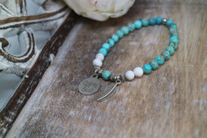 Blue Sea Sediment Jasper with white Howlite bead bracelet with silver 'gypsy soul' and feather charms