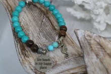 Load image into Gallery viewer, Turquoise gemstone and wood beaded bracelet with silver 'the beach is my happy place' and seahorse charms
