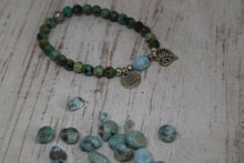 Load image into Gallery viewer, African Turquoise gemstone beaded bracelet with a Larimar nugget gemstone bead, silver 'love faith hope' and heart charm
