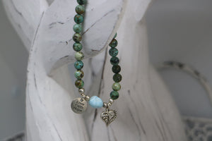 African Turquoise gemstone beaded bracelet with a Larimar nugget gemstone bead, silver 'love faith hope' and heart charm