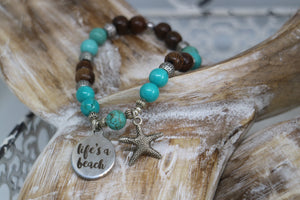 Turquoise gemstone and wood beaded bracelet with silver 'life's a beach' and starfish charms