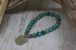 Blue Sea Sediment Jasper beaded bracelet with rustic silver 'dreaming of the sea' charm
