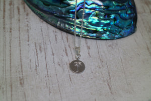 Silver rhodium palm tree coin necklace