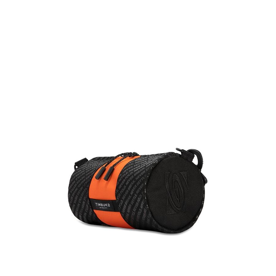 State Of Flux X Timbuk2 Mini Hustle Duffel in black and orange