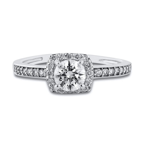 Beautiful Designer Platinum Solitaire Ring for Women with a raised solitaire. This photo depicts how the rings looks from the front the laid down on a table.