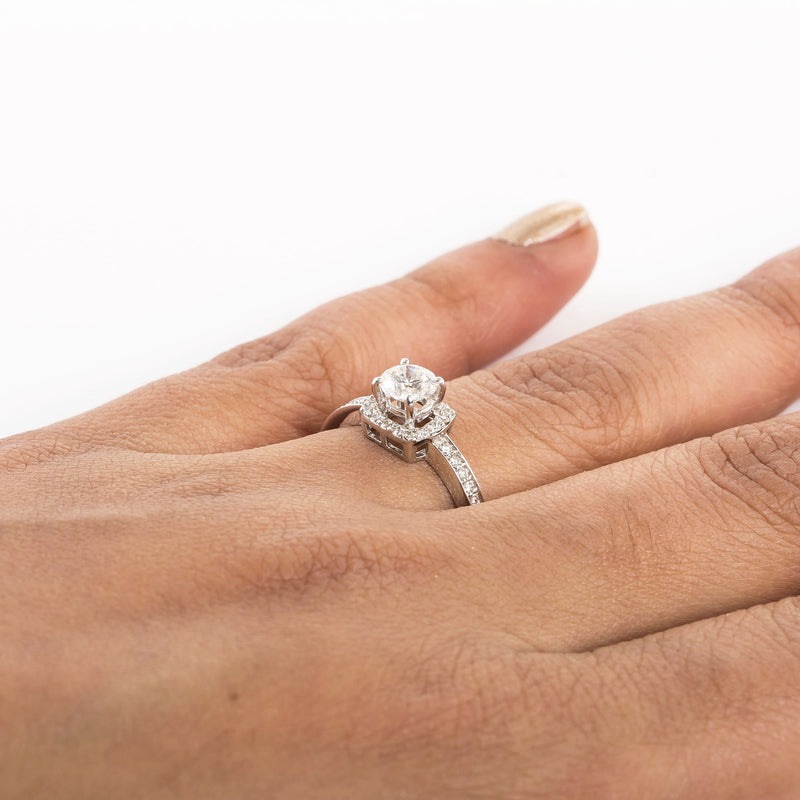 Beautiful Designer Platinum Solitaire Ring for Women with a raised solitaire. This photo depicts how the rings looks when worn in a finger of a deserving lady.