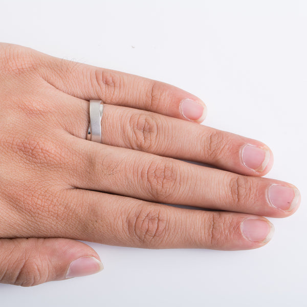 Finger Shot of Plain Platinum Ring with a Twist for Men. This view shows how the platinum ring looks when worn by men.