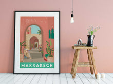 Load image into Gallery viewer, Vintage inspired travel print of Marrakech, Morrocco. Gentleman sitting in alleyway with cats and plants