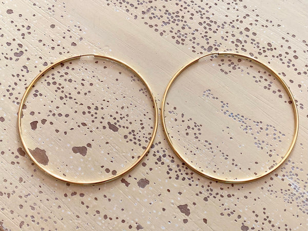 Thin 14k Gold Hoops with Infinity Clasp by Carla