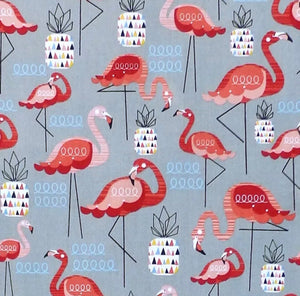 Flamingo and pineapples on grey fabric