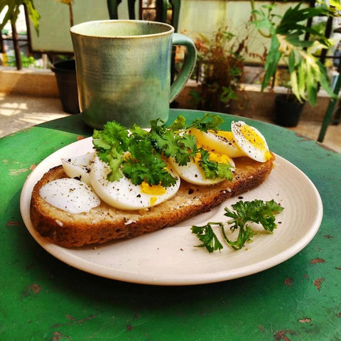 Boiled egg and parsley on toast