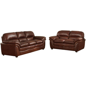 This handsome cognac brown bonded leather sofa and loveseat set possesses the appeal of an old, well-loved leather seat. Rich and sophisticated. Shop now