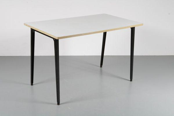 1950's Revolt dining table by Friso Kramer, manufactured by Ahrend de Cirkel in the Netherlands