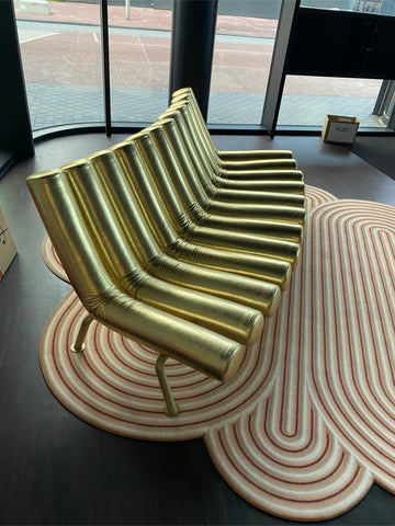Gufram gold convex disco sofa