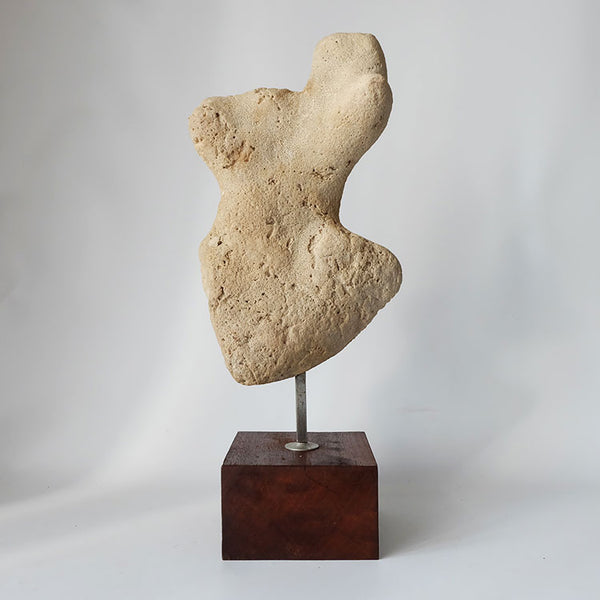 Tweedehands design Stone stylized torso sculpture on a wooden base, period 1970's 1980's