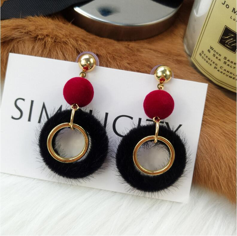 Korean personality autumn and winter earrings female simple temperament new wild net red long earrings fur ball factory direct sales