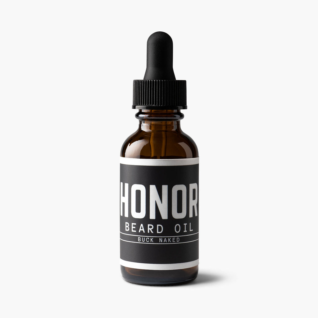 Buck naked unscented beard oil on white background with light shadow