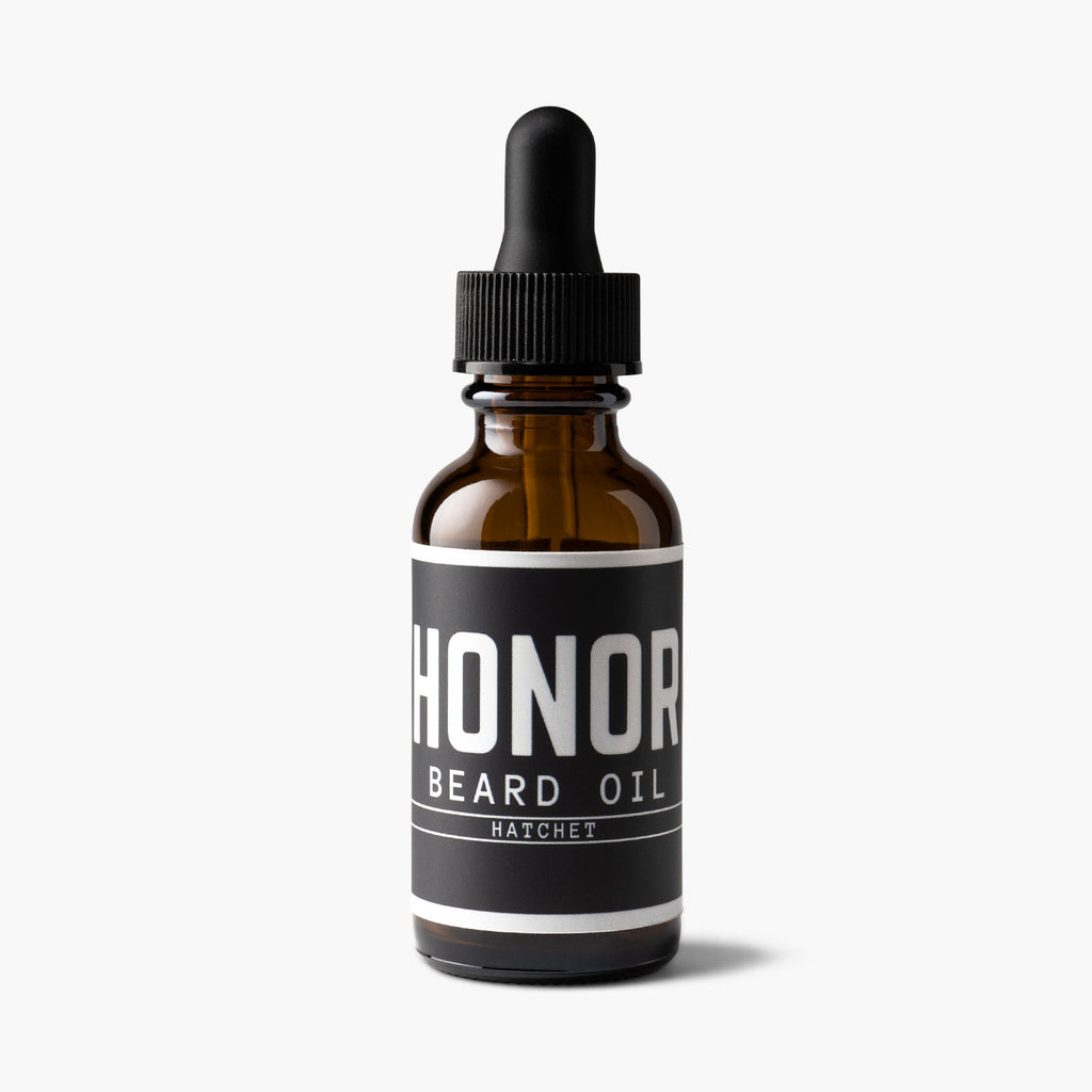 Honor's hatchet blend beard oil under spotlight and sitting on a white backdrop