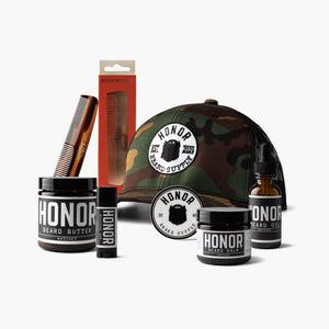 Honor's outfitter beard kit which includes a beard oil, beard butter, beard balm, mustache wax, trucker snapback hat, kent comb and sticker