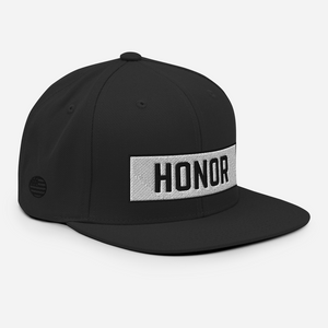 Honor Block Snapback Hat in black on a white background