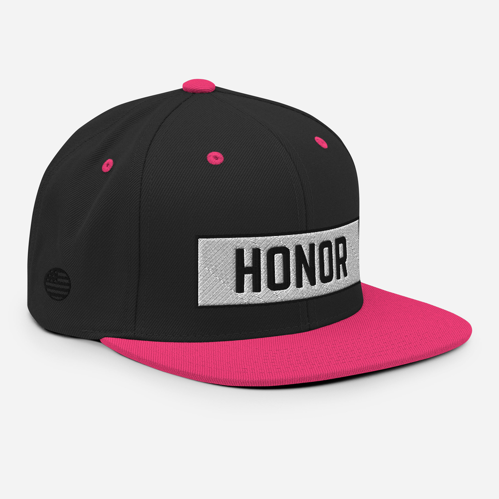 Honor Block Snapback Hat in black and pink on a white background