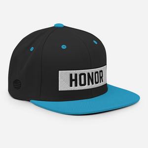 Honor Block Snapback Hat in black and blue on a white background