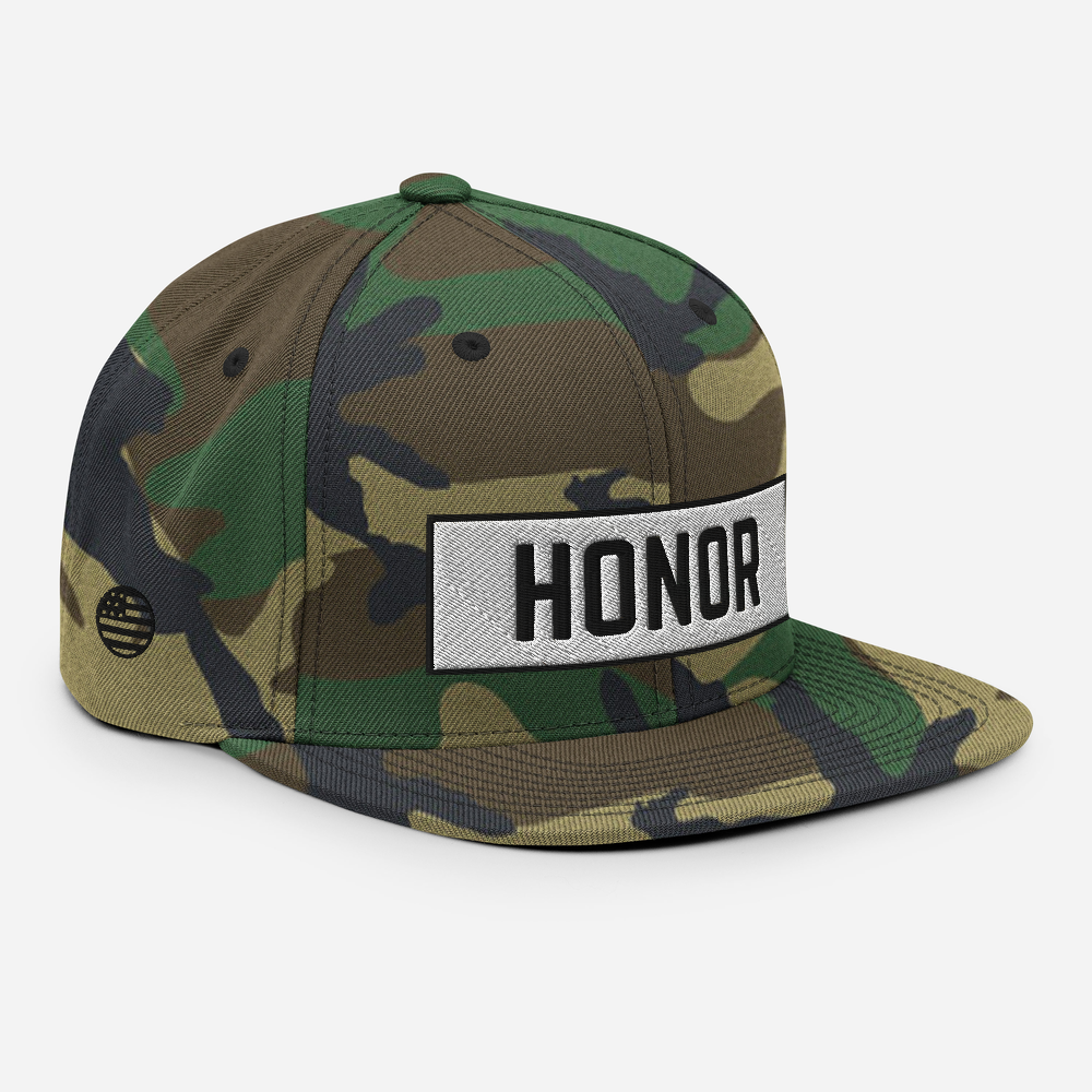 Honor Block Snapback Hat in camo on a white background