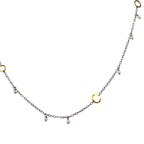 The Delicate Necklace With Circles And Stones