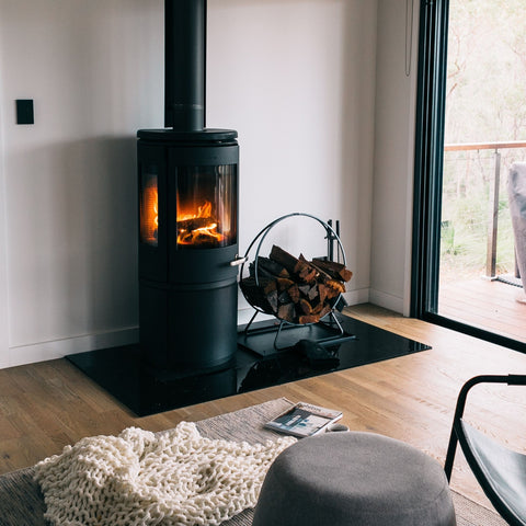 A contemporary flair on a traditional iron firewood store