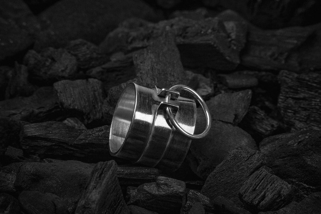 Wide silver ring with an o-ring