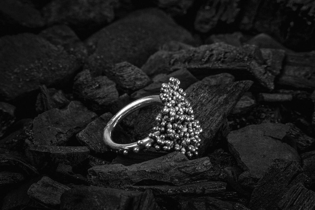 Silver ring with droplets