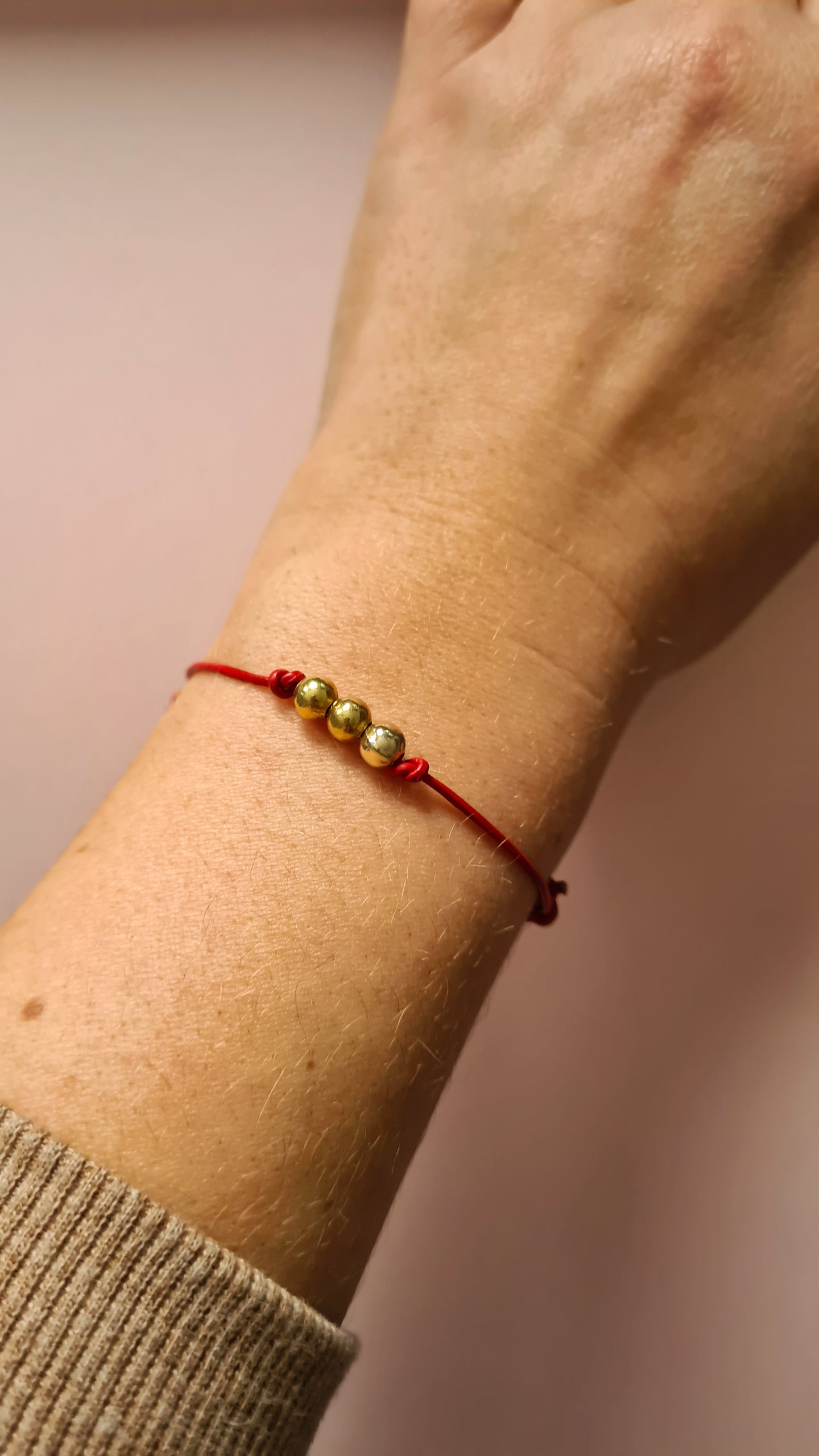 Protection Red Bracelets with Gold Beads  on a Cord