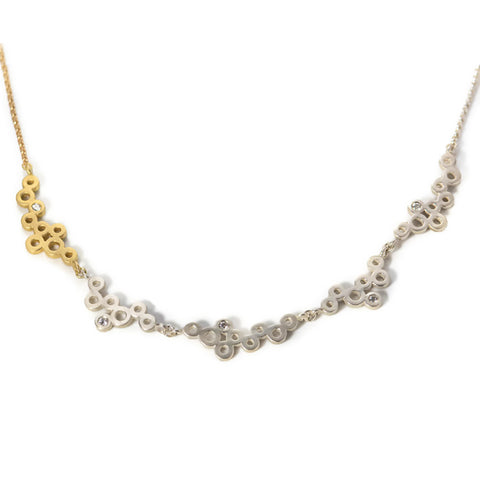 Cloudy with a chance of sparkle necklace in gold and silver