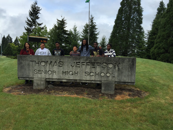 Richard Sherman takes pictures with students at Thomas Jefferson High School
