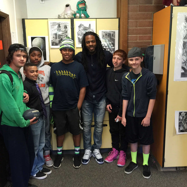 Richard Sherman and Cedar heights students pose for a picture