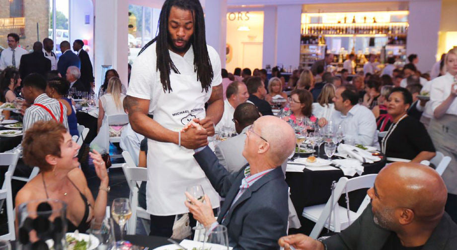 Michael Irvin, Troy Daniels and Marshawn Lynch will be celebrity waiters at Michael Robinson's fundraiser in Richmond | Richard Sherman