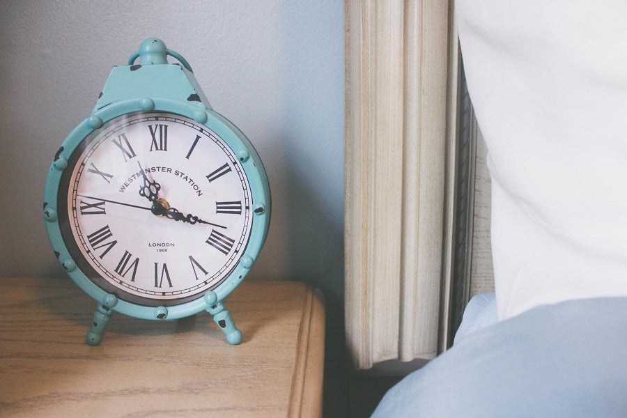 a teal clock on side table