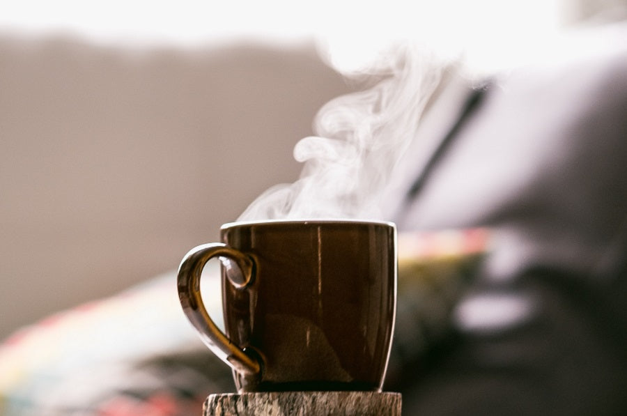 steam coming out of a brown mug