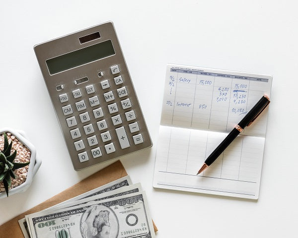 calculator and pen with a budget