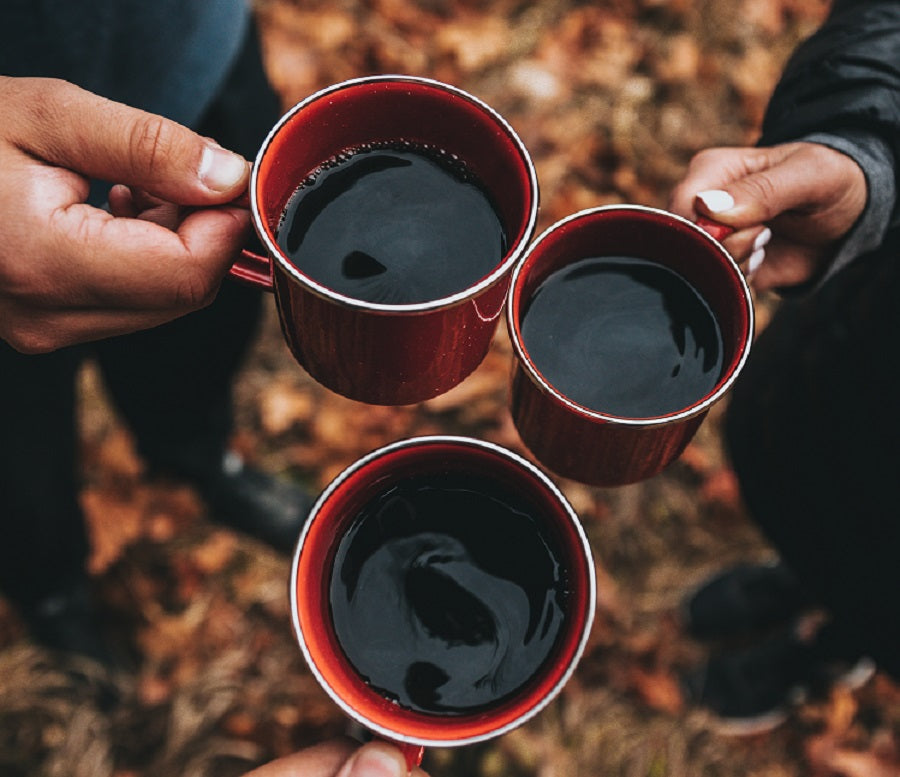 three red mugs filled with coffee