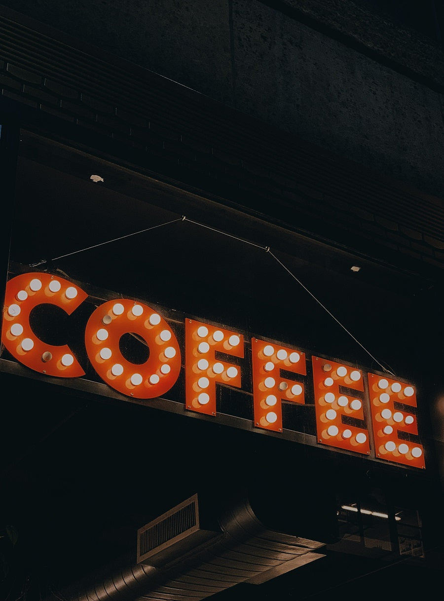 sign that says coffee in lights