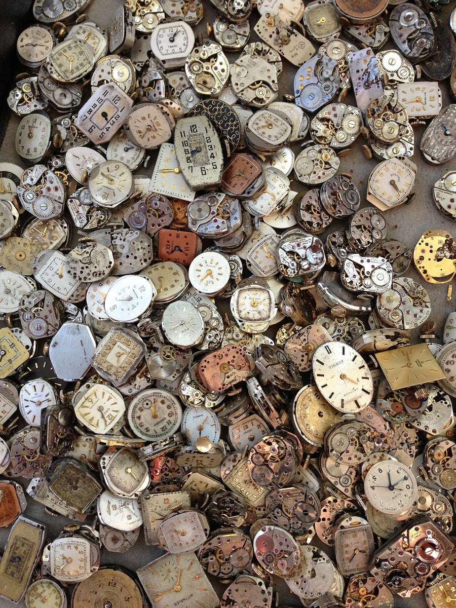 hundreds of watch faces in large pile