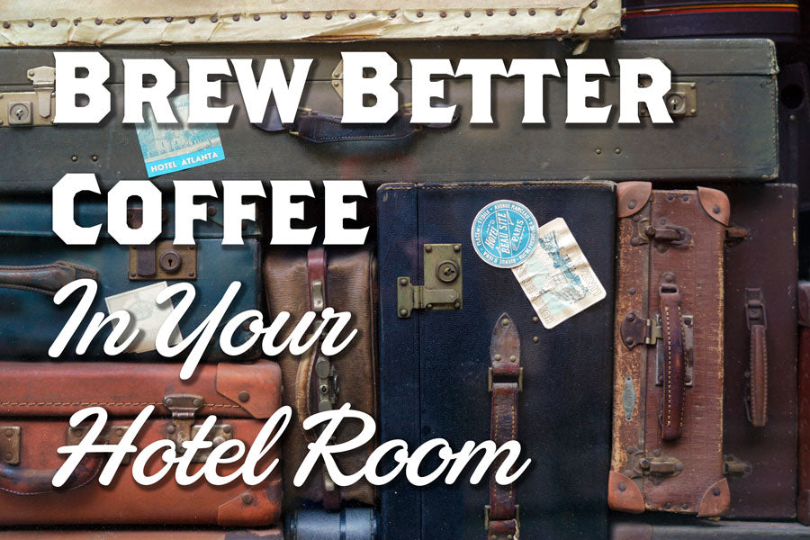 Vintage Suitcases are stacked in a neat pile, the words Brew Better Coffee in Your Hotel Room are overlas
