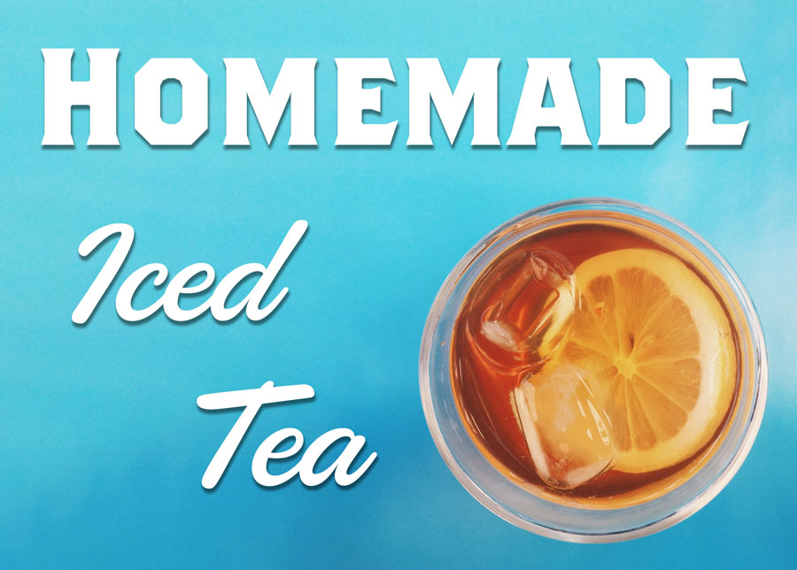Looking down on a glass of Iced Tea with a slice of lemon floating at the top, the text Homemade Iced Tea is overlain over the blue background